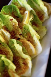 Spicy Caesar Little Gems Recipe -- Little Gem Lettuce leaves hold all the classic flavors of a traditional Caesar salad with a kick of heat to bring it over the top.