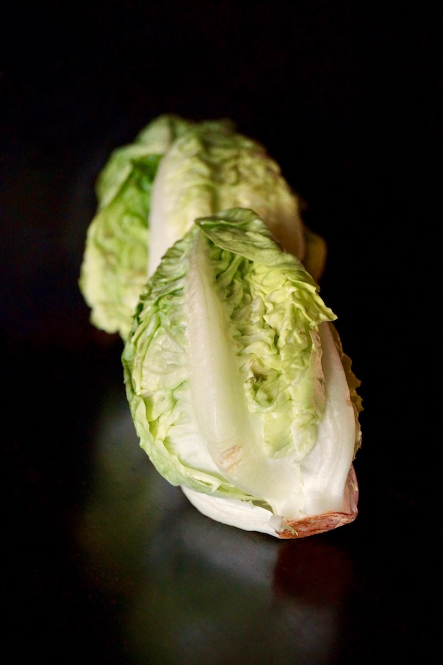 there heads Little Gem lettuce with black background