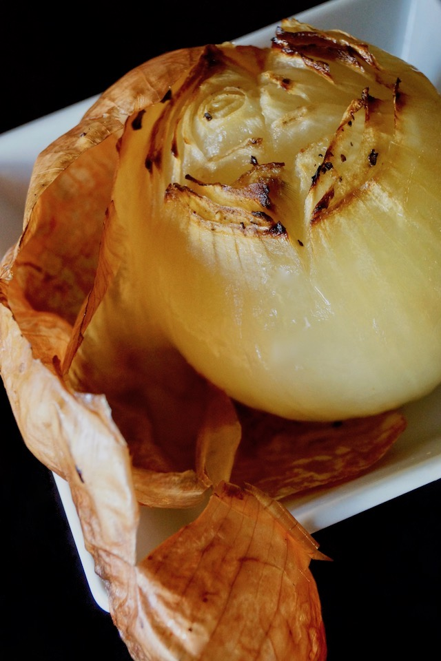 one large Whole Roasted Onion with skin peeling off