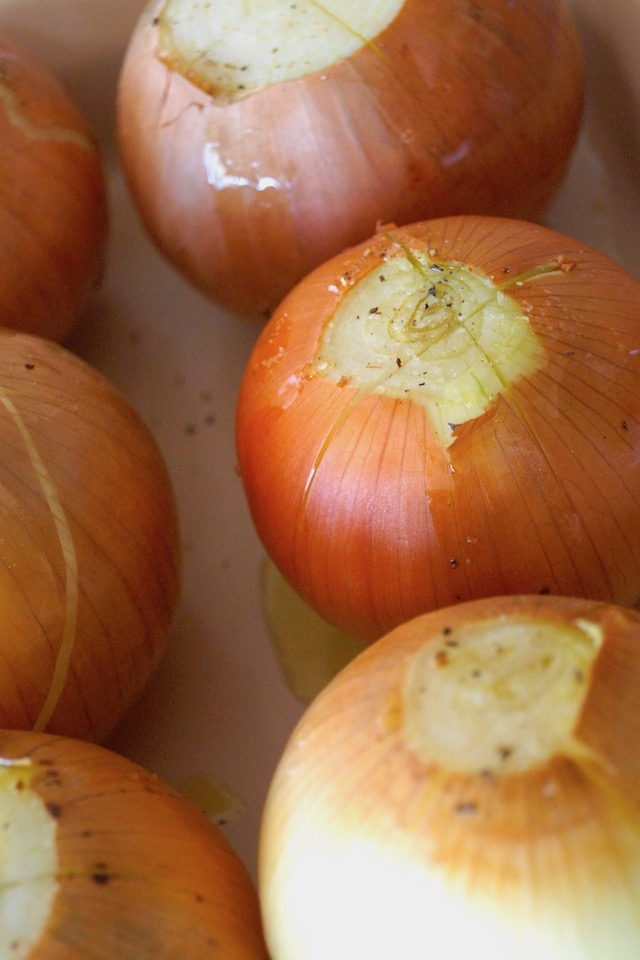 six whole raw onions with X slits made at the top