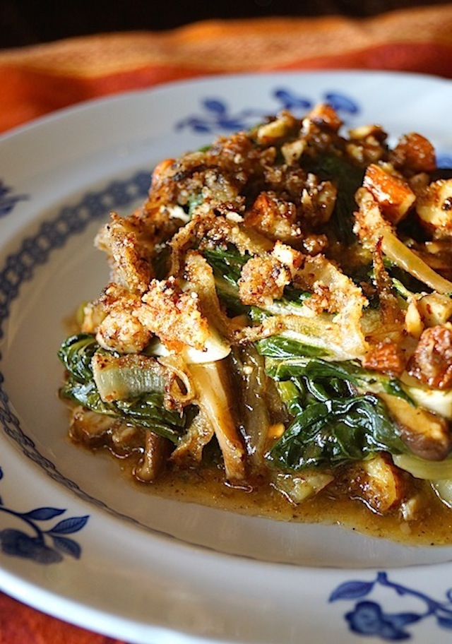 one serving of Bok-Choy-Shitake-Mushroom-Gratin on a white plate with blue flowers ont he rim