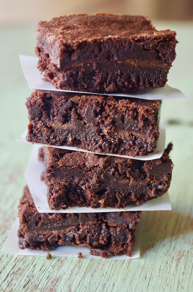 stack of four gluten-free Chocolate Mint Brownies with parchment between each one