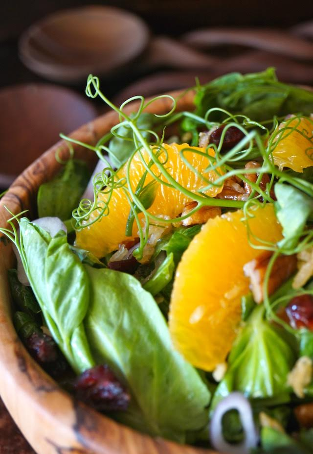 Snow Pea Shoot Salad with Spicy Pecan Dressing -in a wooden bowl