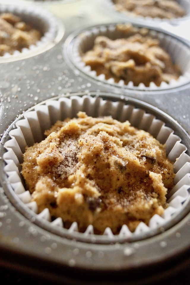 Cappuccino Chocolate Chip Muffin batter in paper cup in muffin tin.