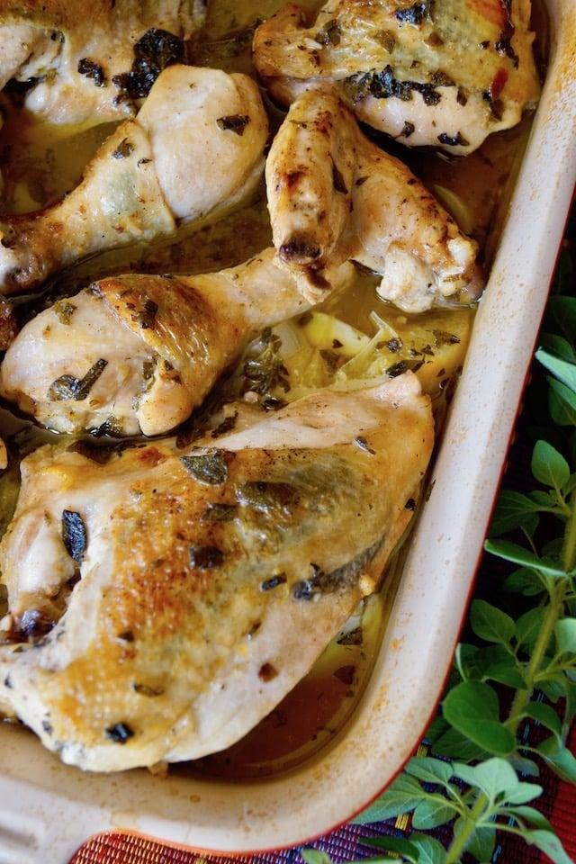 Oregano-Lemon Butter Braised Chicken in a baking dish