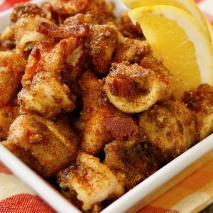 Smoky Bacon Fried Calamari -- A gluten-free, fried calamari strewn with bits of bacon and laced with its smoky flavor.