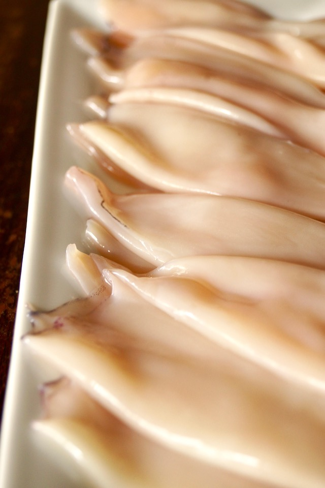 whole, cleaned squid on a white plate