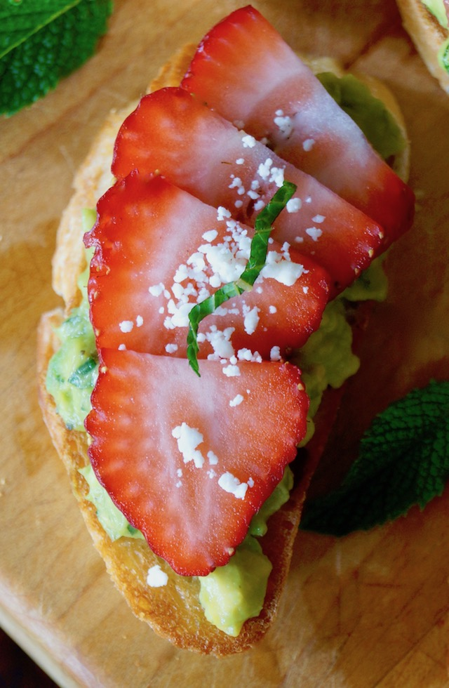 Avocado Toast Recipe with strawberry and mint on cutting board