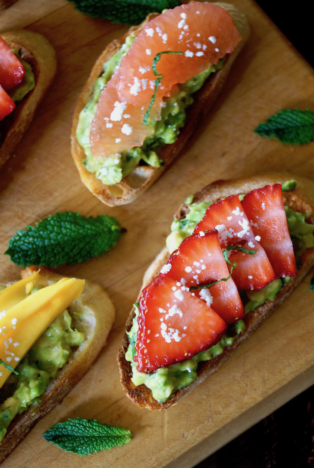 Avocado Toast Recipe with with strawberry, mango and grapefruit on cutting board