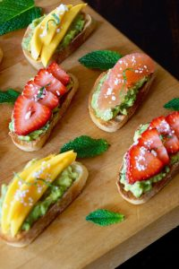 Minty Avocado Toast Recipe-Three Ways -- Fresh, beautiful fruit is a beautiful touch on minty avocado toast. Oh yes, it's the perfect summer appetizer!