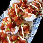 Spicy Poke Nachos on a pretty blue floral plate