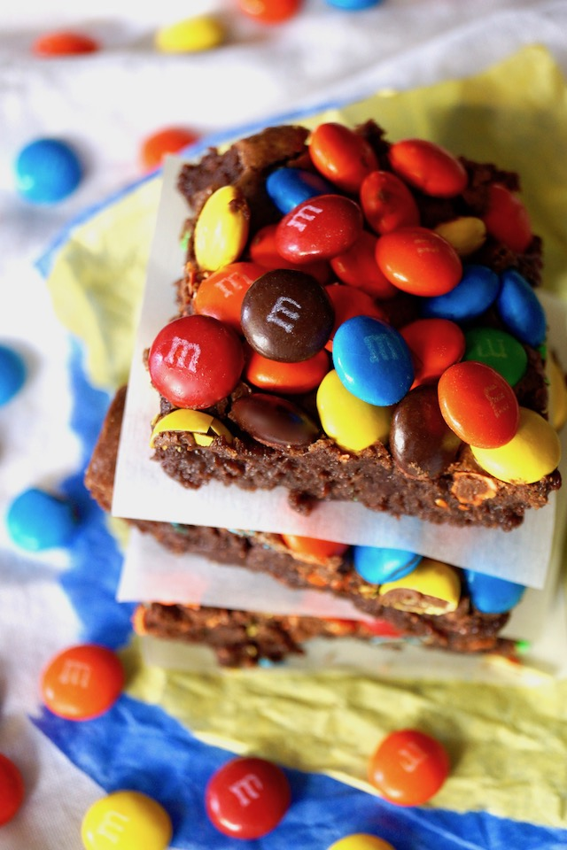 stack of brownies with small pile of M&M's on top