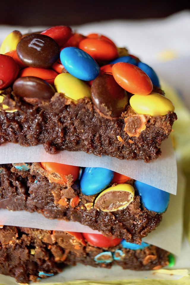 close up of three brownies with M&M's on top