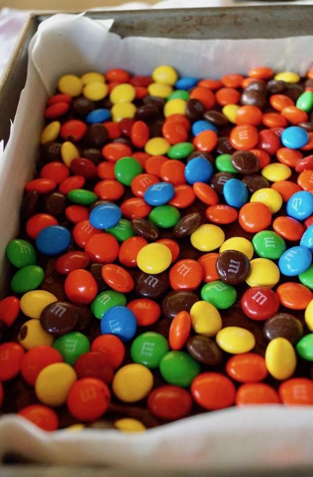 M&M's spread out evenly over brownies in pan