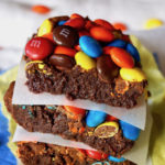 Stack of 3 M&M Brownies with parchment between them