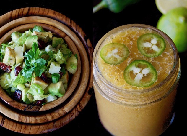 Jalapeno-Lime Vinaigrette in a jar with three slices of jalapeno and salad in wooden bowl