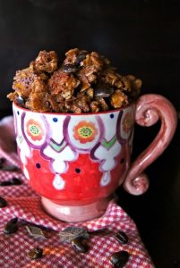 Chocolate granola in a pretty painted mug