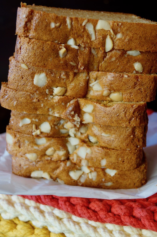 Gluten-Free Macadamia Nut Honey Bread sliced and standing on end