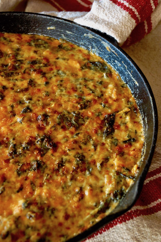 Gruyère Spinach Dip Recipe with Spices and Artichokes in cast iron skillet