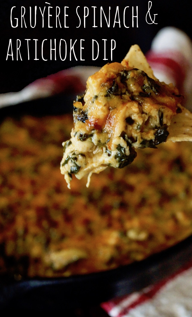 Gruyère Spinach Dip Recipe with Spices and Artichokes with one big bit on a chip.