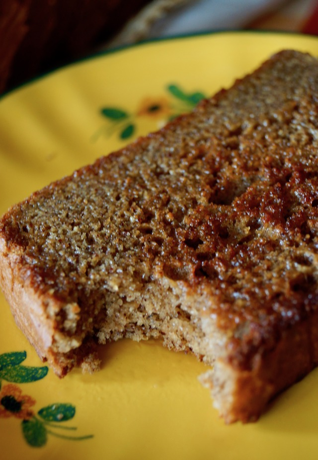 slice of toasted Gluten-Free Almond Butter Bread on a pretty yellow plate, with one bite taken out of it