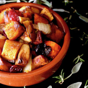 Balsamic Roasted Squash with Cranberries in a terra cotta dish