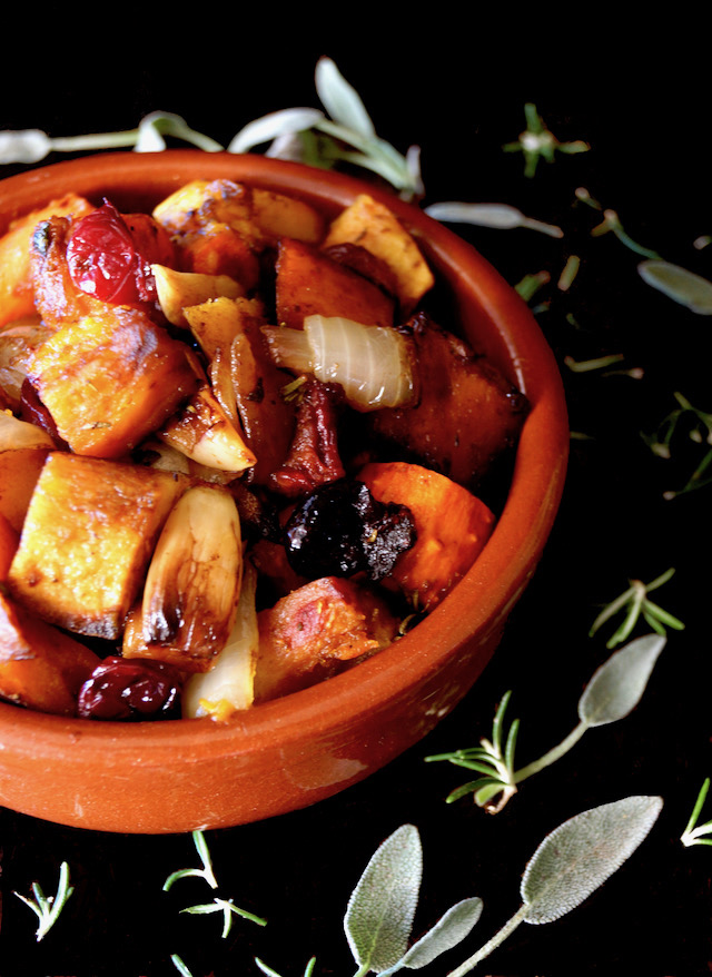 Balsamic-Herb Cranberry Roasted Squash in a terracotta bowl