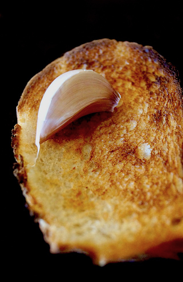 plain toast with one garlic clove on top, not peeled