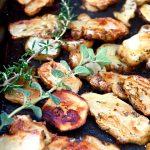 Herb Roasted Sunchokes with fresh rosemary and oregano sprigs