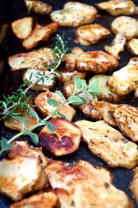 Herb Roasted Sunchokes with fresh rosemary and oregano sprigs