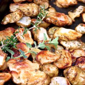 Roasted Sunchokes with fresh herbs on baking sheet
