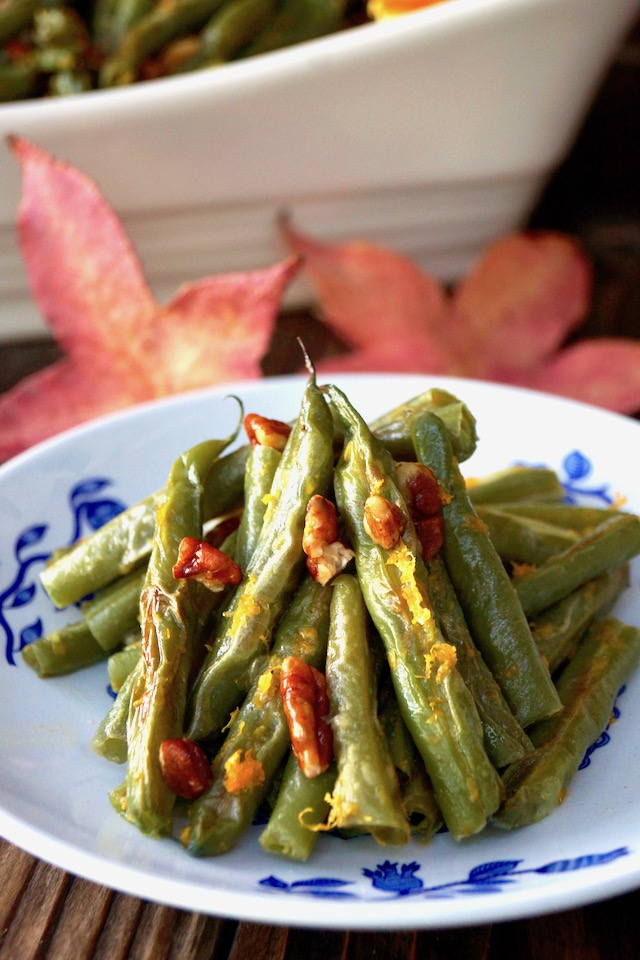 green beans with pecans on white plate with blue flowers