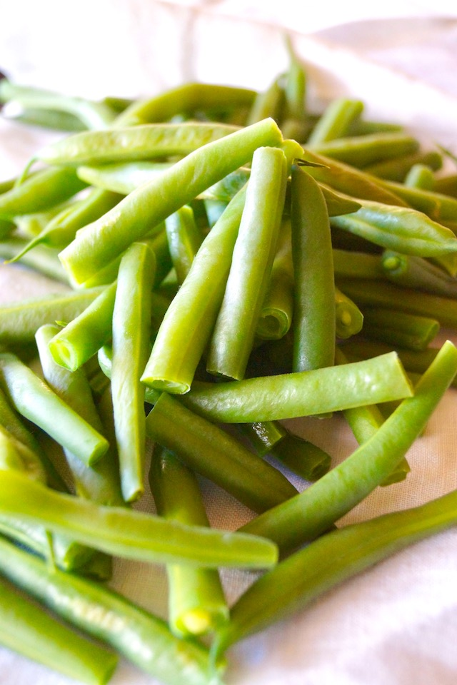 pile of fresh green beans with white background