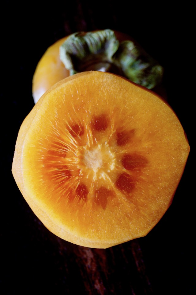 Fuyu persimmon sliced in half