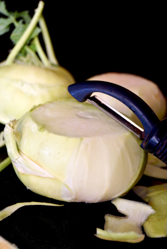 kohlrabi partially peeled, and vegetable peelr
