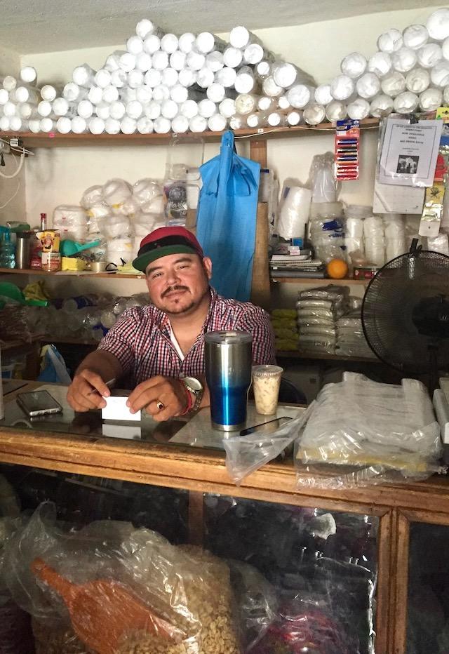 Gabriel Vesquez inside his store, Semillas y especias El Gavilan in Loreto, Mexico.