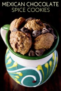 Small Mexican Chocolate Spice Cookies in a pretty ceramic green, cream and yellow mug, with title at the top.