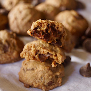 3 stacked Mexican Chocolate Spice Cookies on a white cloth napkin.