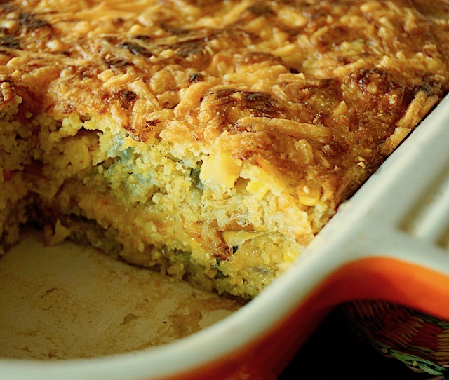 Hatch Chile Cornbread Casserole with one slice removed in pan.