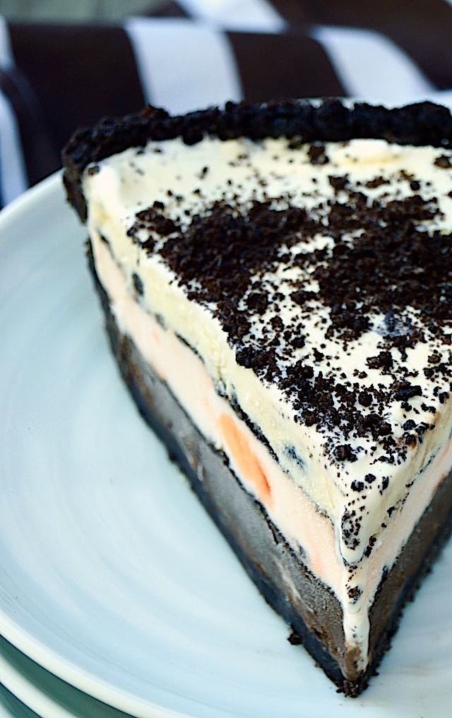 Close up of a slice of Chocolate Peppermint Ice Cream Mud Pie on a white plate.