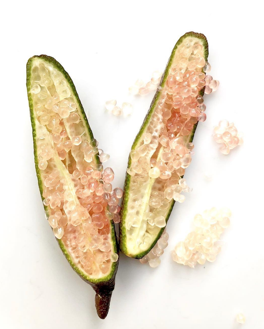 One finger lime, sliced in half, lenghtwise