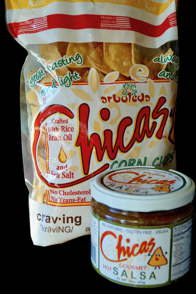 Bag of Chicas Chips and jar of salsa for Spiced Pulled Pork Nachos.