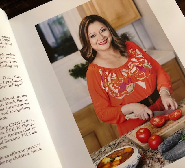Photo of ALicia Maher in her cookbook.