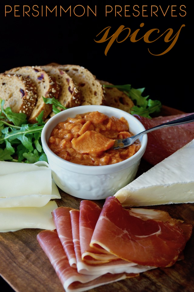 Spicy Persimmon Preserves in a white bowl surrounded by meats, cheeses and bread slices with the title at the top