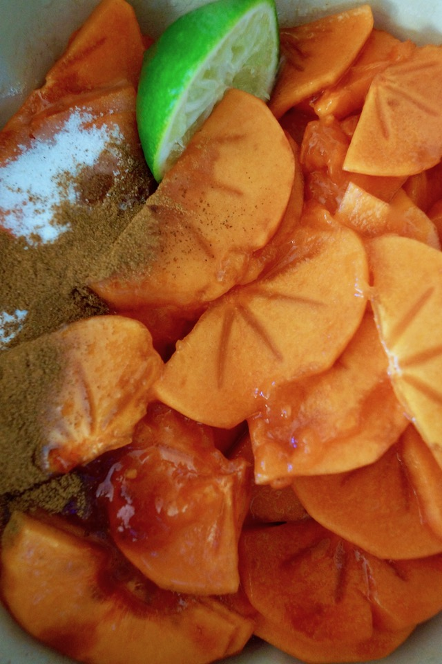 Bowl of persimmon slices and spices.