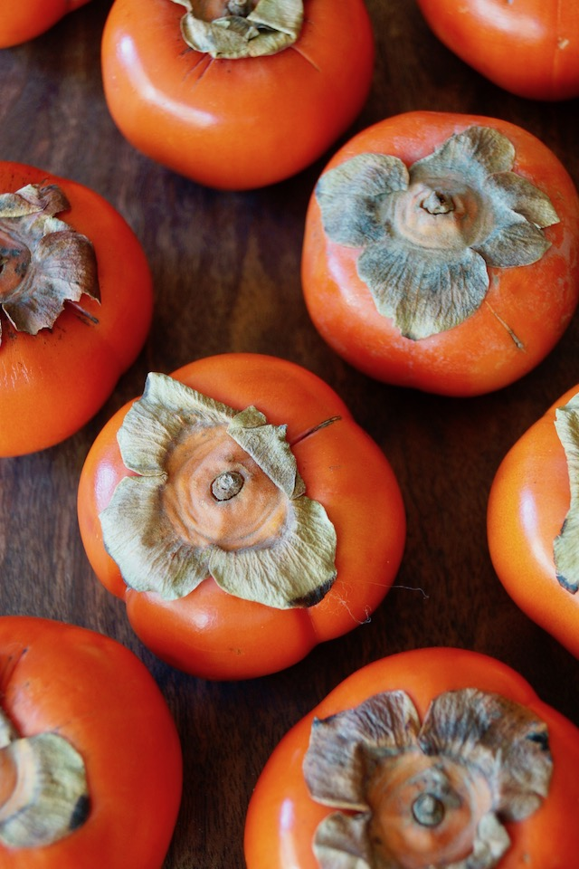 top view of several Fuyu persimmons.
