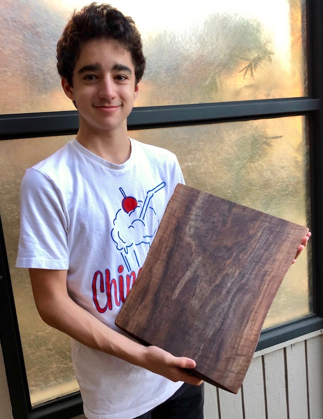 boy holding a cutting board