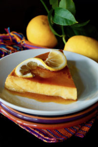 One slice of Meyer Lemon Flan on a white plate.