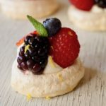 Close up of one Mini Lemon Berry Pavlova with mint leaf