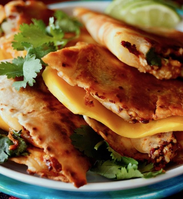 Mango-Chipotle Quesadillas on blue plate with lime